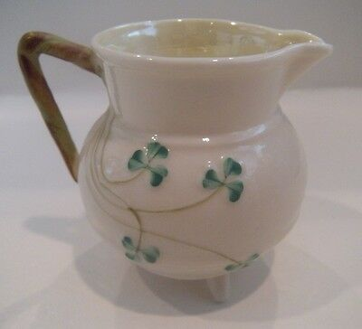 VINTAGE BELLEEK IVORY WITH GREEN CLOVERS FOOTED CREAMER 6TH MARK