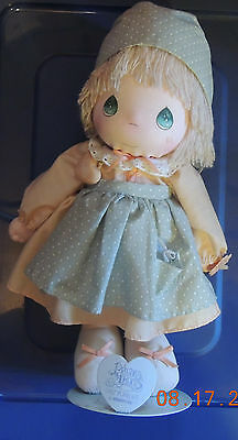 2 dolls one a porcelain with windup music box the other a soft precious moments