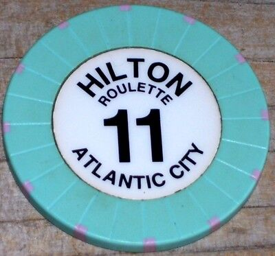 ROULETTE CHIP (A) FROM THE ATLANTIC CITY HILTON CASINO