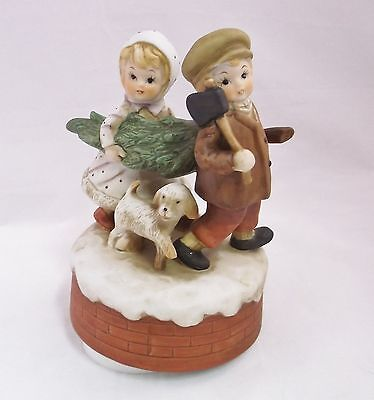 Revolving Bisque Porcelain Music box Plays Babes in Toyland Children and Dog