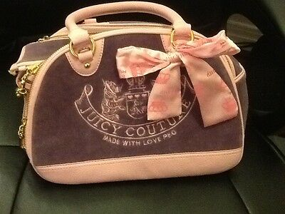 Pink and Purple Juicy Couture dog carrier