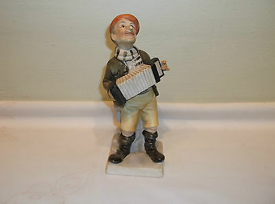A Cute Enesco Street Playing Squeeze Box Player