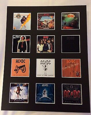 "AC/DC DISCOGRAPHY PICTURE MOUNTED 14"" By 11"" READY TO FRAME"