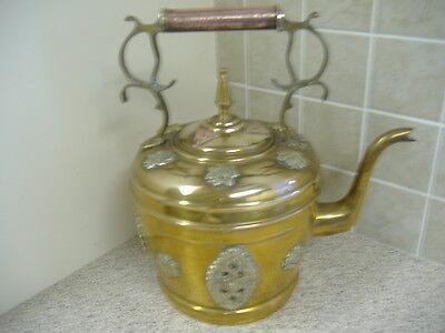 large ornate brass and copper kettle