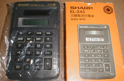 Rare Vintage Sharp EL-243 solar cell calculator in dark gray with Japanese box
