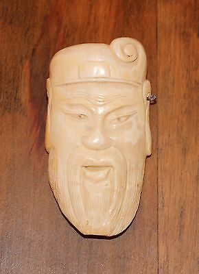 CHINESE CARVING OF MAN'S FACE WITH BEARD AND CAP   3 1/2 X 2
