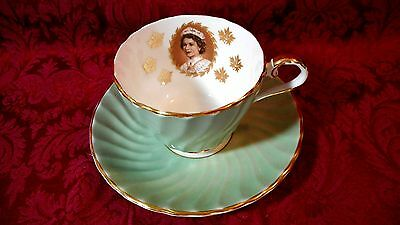 1959 AYNSLEY GREEN & GOLD CUP / SAUCER.  QUEEN ELIZABETH II AT ST. LAWRENCE SW.