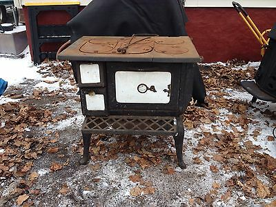 Antique Sears And Roebuck wood burning cooking stove