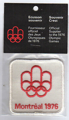 Orig.clothe badge  Olympic Games MONTREAL 1976  -  OFF.LOGO (white) in Orig.pack