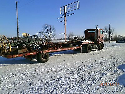 1991 Ford Single Cab Semi with a Great Lake Drop Deck Flatbed Trailer