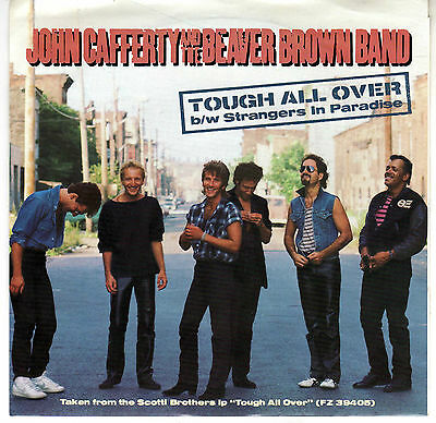JOHN CAFFERTY: TOUGH ALL OVER / STRANGERS IN PARADISE 45 RPM
