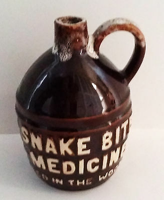 """Pottery Jug Says """"Snake Bite Medicine Aged In The Woods"""""""