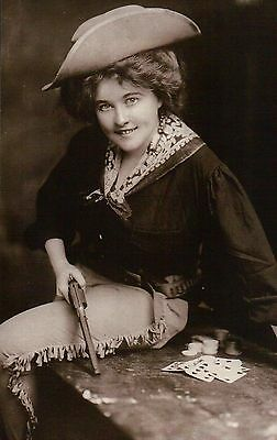 """ Winning Hand "" Cowgirl with Playing Cards & Revolver, Hat, c 1900 --- Postcard"