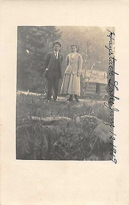 Haystack Lake Oregon? Couple by Log Cabin Scenic Real Photo Antique PC (J34520)