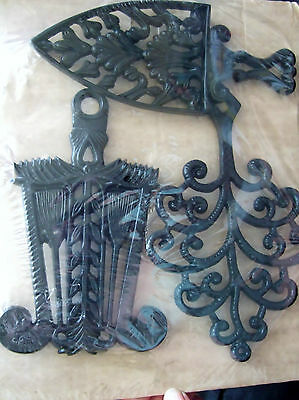 Black plastic wall trivets vintage reproductions  set of 3 new on card
