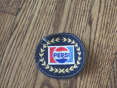 pepsi  patch. nos,70's,black bacround embroidery on felt.,no border
