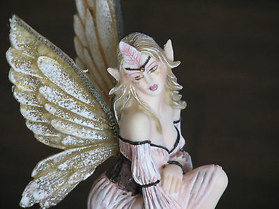 Resin Fairy with Golden Wings, Sitting on Log with Mushrooms