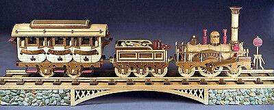 Woodworking plans for building an 1835 British three car train with tracks