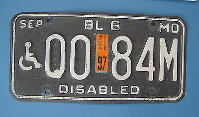 1997 Missouri Disabled Handicapped license plate.