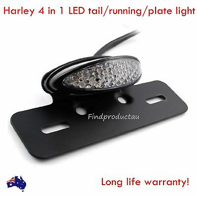 Black motorcycle LED tail light with license plate mount Harley bobber chopper