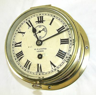 Antique Brass Cased Bulkhead Marine Ships Clock : M. I. LIMITED LONDON ENGLAND