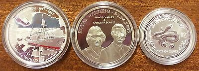 2001, 2005 and 2007 silver coins as pictured in capsules only