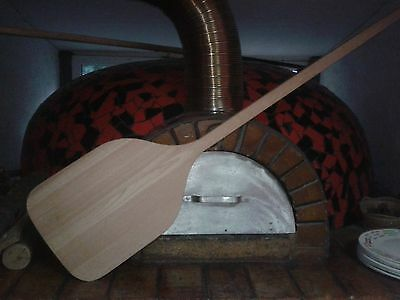 wooden pizza paddle into the furnace