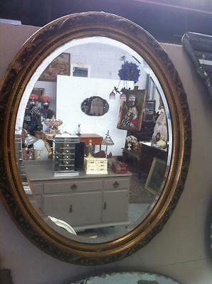 OVAL ANTIQUE CARVED GILT FRAMED WALL MIRROR H60 x W49 cm