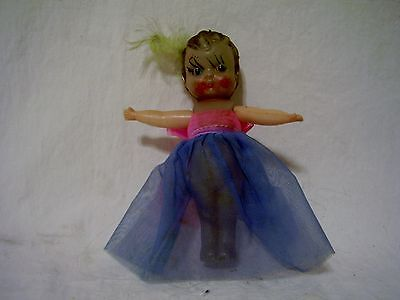 Vintage celluloid kewpie doll - arms are movable - feather in hair/organz outfit