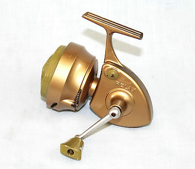 LUXOR RELAX gold finish spinning fishing reel in very fine condition