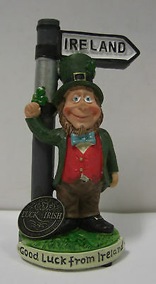 Ireland Leprechaun At Signpost With Shamrock In His Hand Good Luck From Ireland