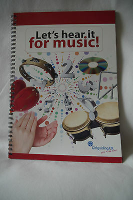 A vintage Girl Guide music book Let's hear it for music.