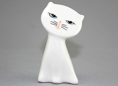 A 1980s Korean white art pottery cat. Signed. Hand painted. Cute. Stylised.