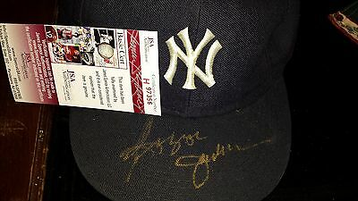 Reggie Jackson owned Yankee hat. Signed gold paint pen. JSA authenticated