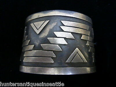 Vintage  Sterling Silver Mexican Cuff Bracelet signed AE ? It has a SW design