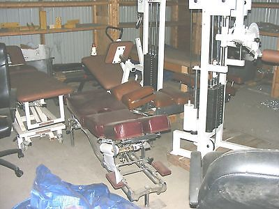 Lot of Chiropractic Tables and Exercise Equipment See Pictures