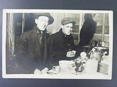 Men Eating In Cabin Swift's Can Antique Real Photo Postcard RPPC c1910