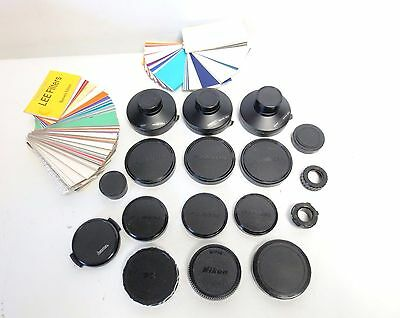 NIKON,FUJINON,HAMA  LOT OF 18 CAMERA LENS CAP COVERS and SWATCH BOOKS OF FILTERS