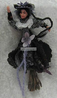 Hanging Witch Ornament Has a Resin Face & Hands With Purple & Black Fabric Dress