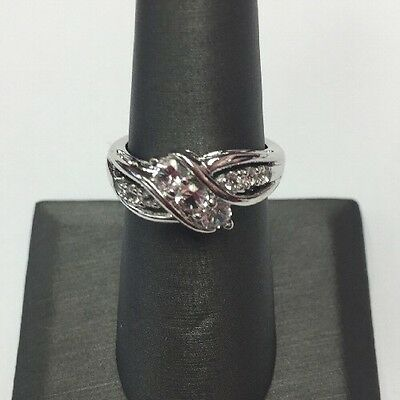 STERLING SILVER SIGNED SUN 3 CZ ROUND WITH 6 CZ SIDE  RING SIZE 6.75 4.1gr