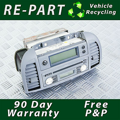 Nissan Micra K12 Radio and CD Player with Fascia Centre Conso2003-2007  FREE P&P
