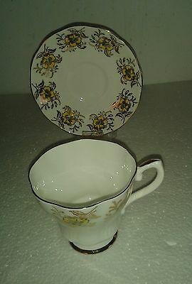 Swirled Royal Grafton yellow flowers in a Gold Gilt Bouquet Tea Cup and Saucer