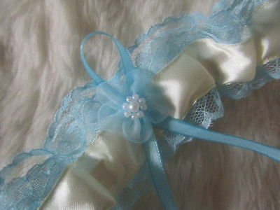Handmade Ivory Wedding Garter Blue Lace, Blue Ribbon and Blue Organza Flower.