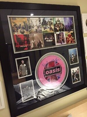 Professionally Framed & Hand Signed OASIS Drum Skin with COA
