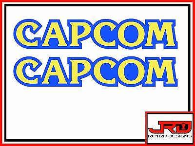 2 x Capcom Logo Vinyl Stickers in Blue & Yellow