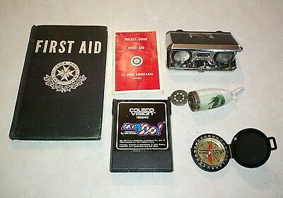 antique lot sale first aid books ceramic pipe binoculars compass mr. do game