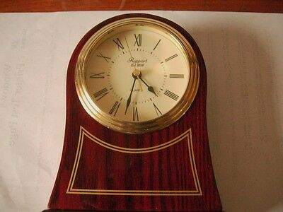 A LOVELY WOODENTIMEPIECE W/BRASS TRIMMINGS by RAPPORT OF LONDON - quartz