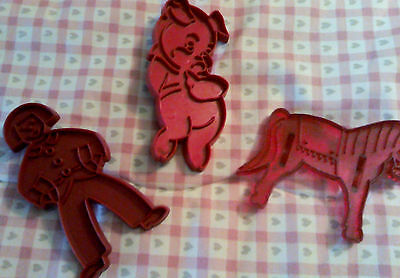 set of 3 vintage red plastic cookie cutters