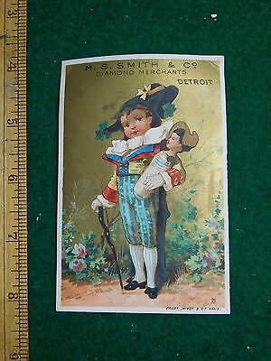 1870s-80s M S Smith Jeweler Engraved Building Girl Fancy Clothes Trade Card F36