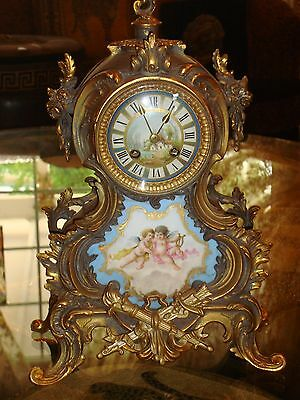 A spectacular antique 1878 French Japy clock with gold carvings